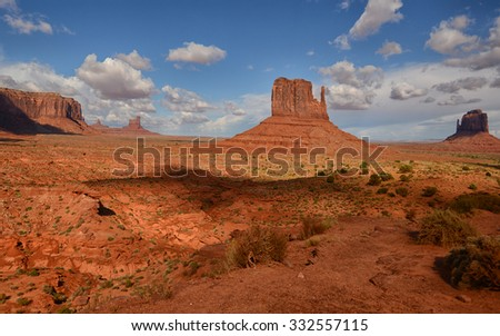 Monument Valley, the mitten monuments,  and buttes with steep hills and flat tops - stock photo