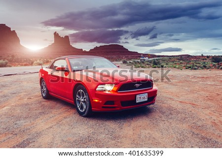 MONUMENT VALLEY ,UTAH, USA JUNE 6, 2015: Photo of a Ford Mustang Convertible 2012 version at Monument Valley,Utah, USA. The fifth generation began with the 2005 model year to 2014.TONED Image.