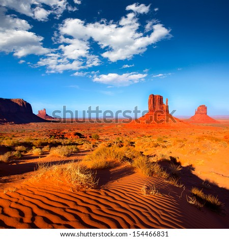 Monument Valley West and East Mittens Butte desert sand dunes Utah - stock photo