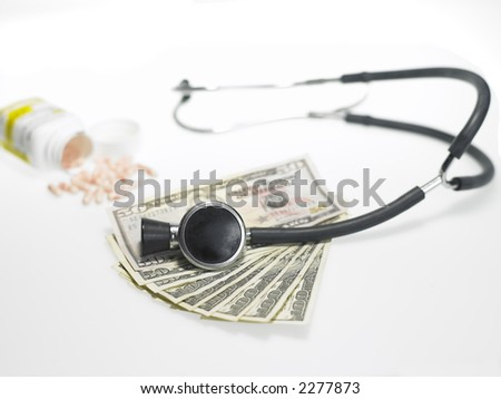 Mony, pills and a stethascope over white background - stock photo