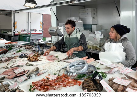 MONZA, ITALY/EUROPE - OCTOBER 28 : Fishmonger and his wife in Monza Italy on October 28, 2010. Unidentified man and woman. - stock photo