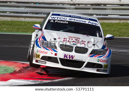 MONZA, ITALY - MAY 22: Andy Priaulx with his BMW 320si. Winner of the 1st place of Race 1 at FIA World Touring Car Championship 2010 in Monza. May 22, 2010 in Monza, Italy - stock photo