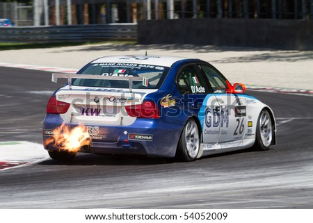 MONZA, ITALY - MAY 22: Stefano D'Aste with his BMW 320si flaming out at FIA World Touring Car Championship 2010 May 22, 2010 in Monza, Italy - stock photo