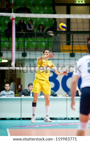 MONZA, ITALY - NOVEMBER, 25: A. Baroti against Barbareschi and Luppi in Vero Volley  Monza ( white ) vs Conad Reggio Emilia  ( Yellow) -Italian Volley A2 League on 2012 Novermber, 25 in Monza (Italy)