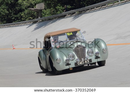 MONZA (MB), ITALY - MAY 17: A green Healey 2400 Westland takes part to the 1000 Miglia classic car race on May 17, 2015 in the Monza race track (MB). The car was built in 1948.