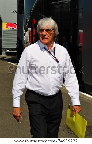 MONZA - SEPTEMBER 11: Bernie Ecclestone checking the paddock at the circuit before starting the formula 1 championship on September 11, 2010 in Monza, Italy - stock photo