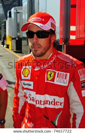 MONZA - SEPTEMBER 11: Fernando Alonso walking from the paddock to the pits on september 11, 2010 in monza, italy, formula 1 - stock photo