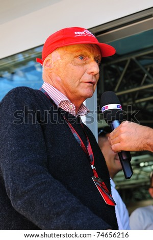 MONZA - SEPTEMBER 11: Formula 1 Driver, Nikki Lauda is talking to the press during the formula one on September 11, 2010 in Monza, Italy - stock photo