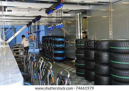 MONZA - SEPTEMBER 11: Racing car tires with heat covers in the paddock on September 11, 2010 in monza, italy, formula 1 - stock photo
