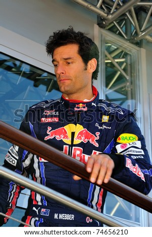 MONZA - SEPTEMBER 11: Red Bull Racing Team Driver, Mark Webber of Australia finished the practice for formula 1 on September 11, 2010 in Monza, Italy - stock photo