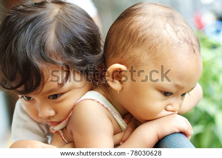 mood expression of two asian siblings children hug - stock photo