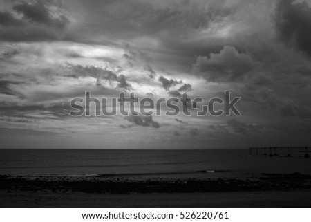 Moody black and white sky over the sea