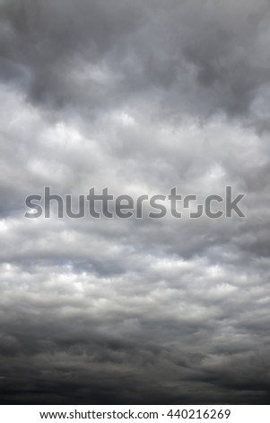 Moody clouds before a thunderstorm. Cloudy sky over horizon. - stock photo