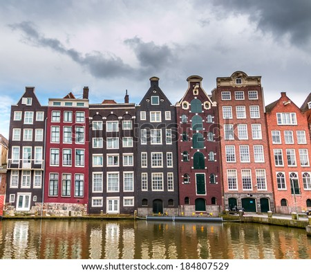 Moody clouds hang over houses built in the 17th century along the canals of Amsterdam.