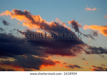 Moody colored cloudscape taken at early evening - stock photo