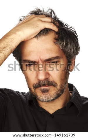 Moody men. portrait of a men holding his head and expressing anger. Studio shot, isolated on white background.