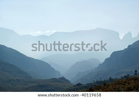 Moody, misty, evening shot of Monk's Cowl in Drakensberg Mountains World Heritage Site - stock photo