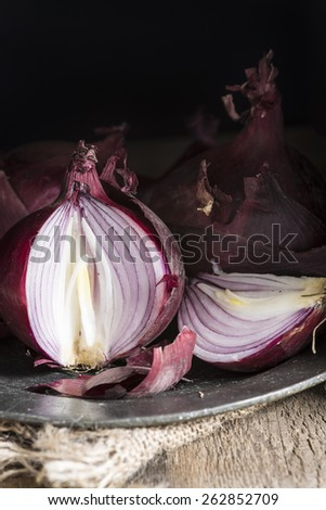 Moody natural light vintage style image of fresh red onions - stock photo
