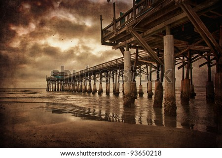 Moody picture of the Cocoa Beach fishing pier at dawn - stock photo