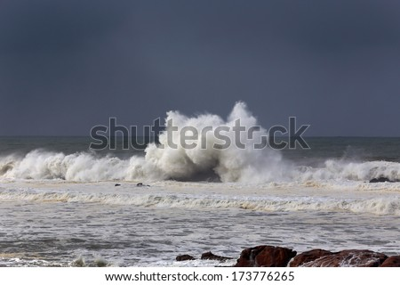 Moody seascape with white wave before storm and rain
