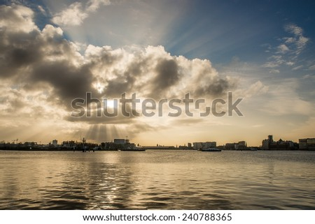 Moody skies over a lake - stock photo