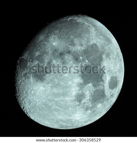 Moon almost full seen from the northern hemisphere with a telescope - cool cold tone - stock photo