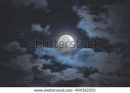 Moon among the clouds on a midnight sky. My astronomy work.