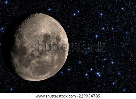 Moon among thousands stars in deep space. - stock photo