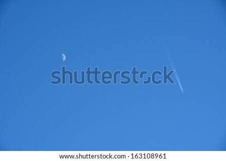 Moon and Airplane - stock photo