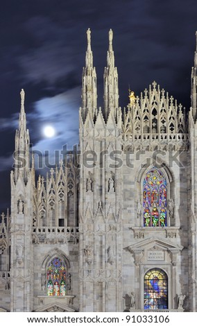 moon and cathedral, Milan Milan (Italy) 2011, 10, 12 cathedral windows illuminated for Christmas celebrations, shot at night under cloudy moon - stock photo
