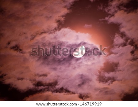 moon and clouds in a night sky - stock photo