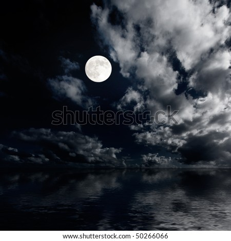 Moon and clouds sky above sea at night image - stock photo