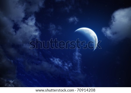 moon and stars in a cloudy night blue sky - stock photo