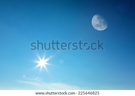 Moon and sun together on the daytime blue sky (Composite image). - stock photo