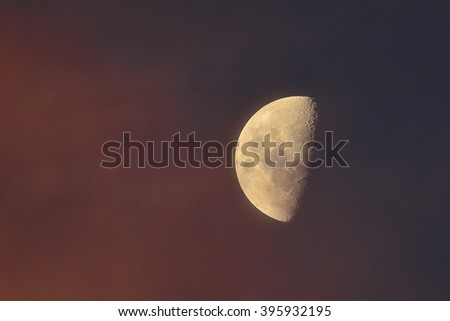 Moon as the sun was setting - stock photo