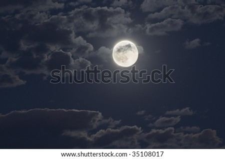 moon at night with a cloudy sky - stock photo