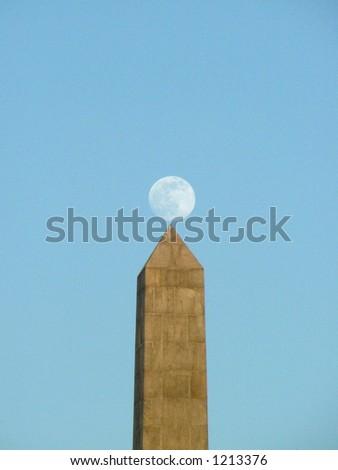 moon balancing on a pillar - stock photo
