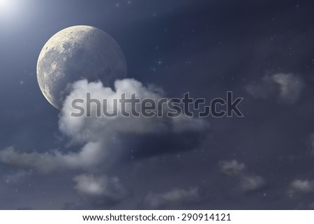 Moon behind clouds and among thousands of stars in deep space. My astronomy work. - stock photo