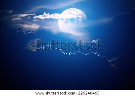 Moon behind clouds with night sky - background image - 3D artwork - stock photo