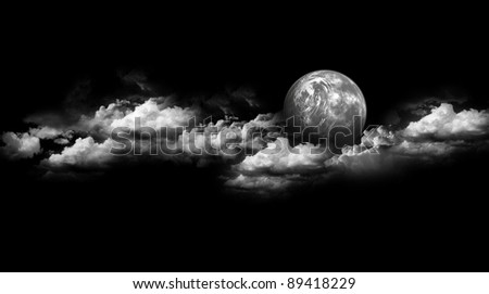 Moon between the clouds black & white - stock photo