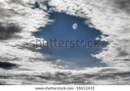 moon breaking through clouds - stock photo