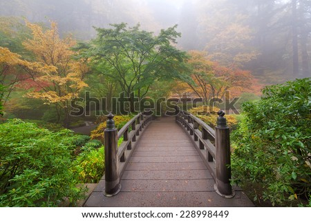 Moon Bridge One Foggy Morning in Colorful Autumn Season at Portland Japanese Garden - stock photo