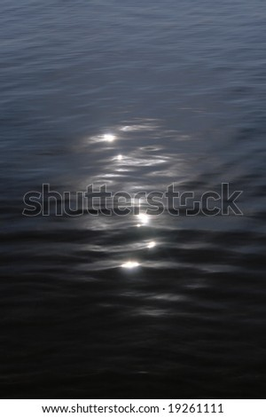 Moon catchlights on night sea water surface - stock photo