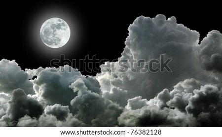 Moon in black stormy clouds - stock photo
