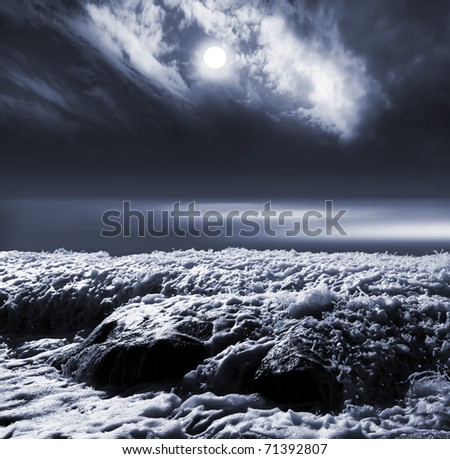 moon in clouds sky above the sea with reflection - stock photo