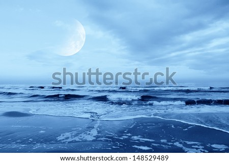 moon in the sky over the sea - stock photo