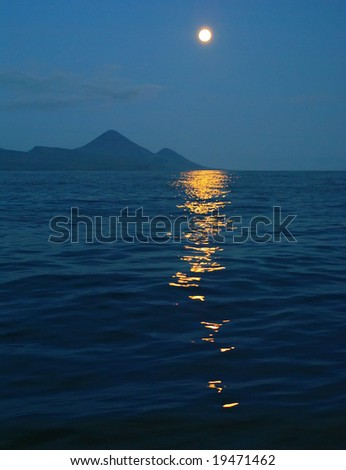Moon light in blue water - stock photo