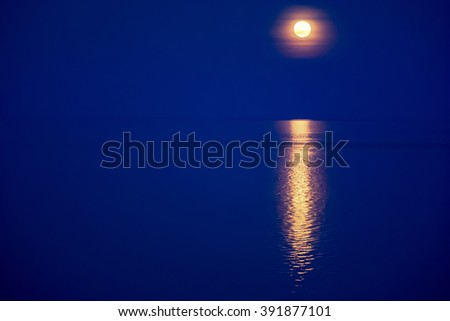 Moon light reflecting in water - stock photo