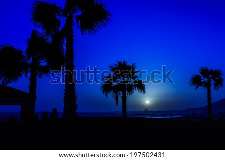 Moon over Atlantic Ocean in Agadir, Morocco - stock photo