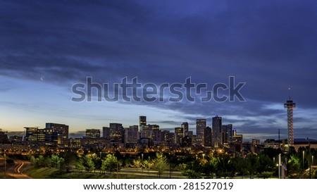 Moon over Denver in the morning twilight - stock photo
